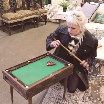 Playing mini pool can be a challenge. This tiny pool table has a