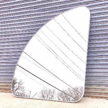 This vintage asymmetrical Italian wall mirror is up for grabs in