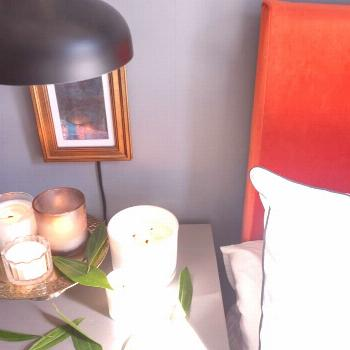White Center Candles on the gray nightstand in bedroom.