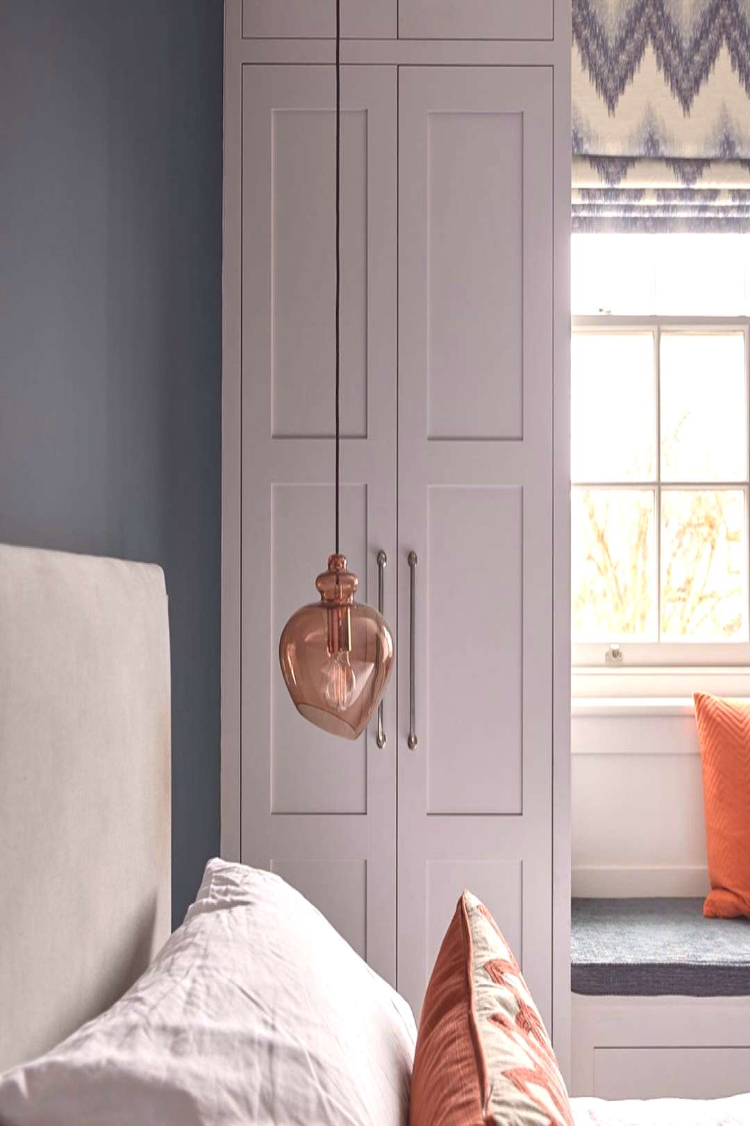 Bespoke fitted modern shaker-style wardrobes and a custom made wi