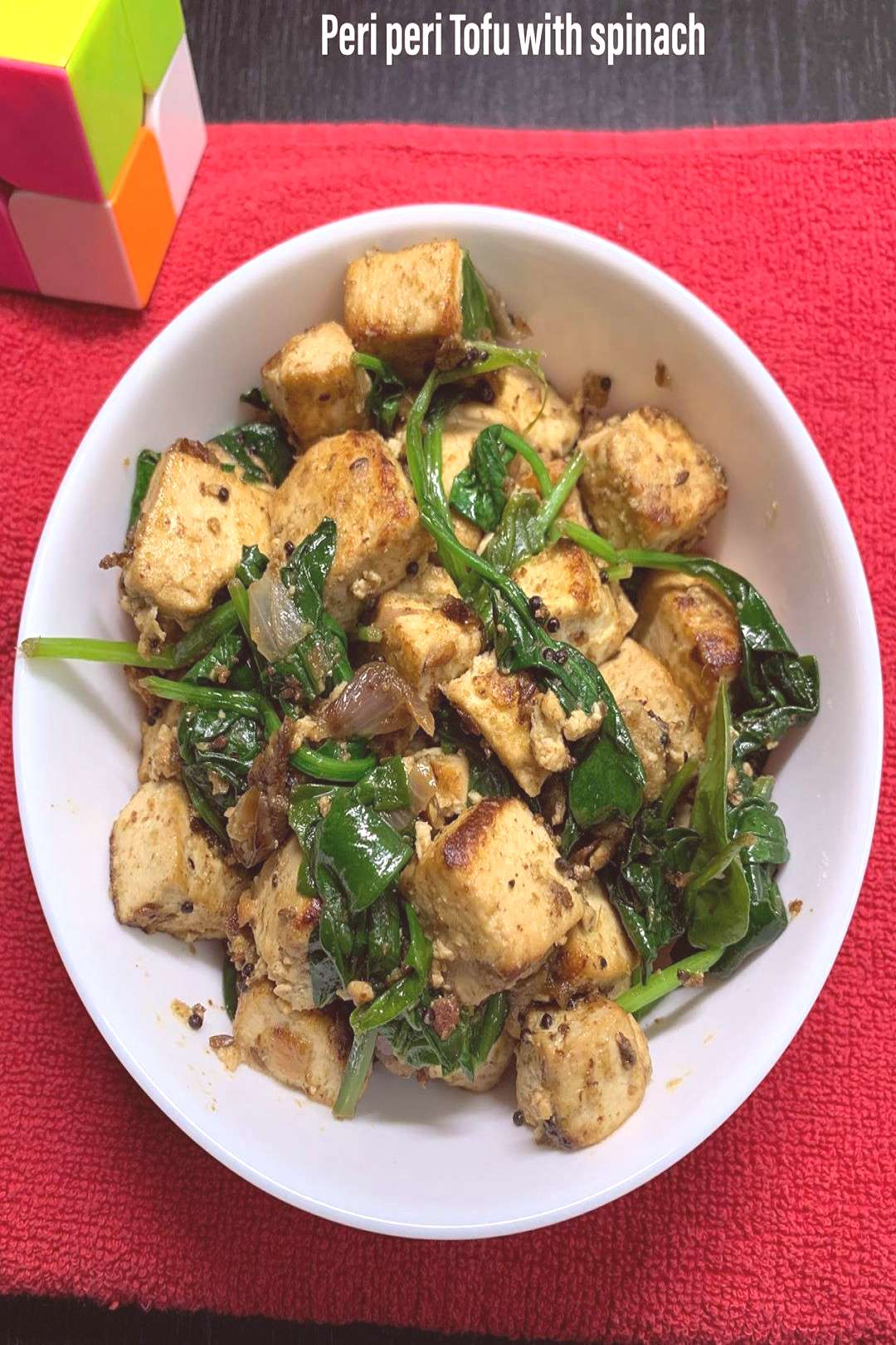food possible text that says Peri peri Tofu with spinach