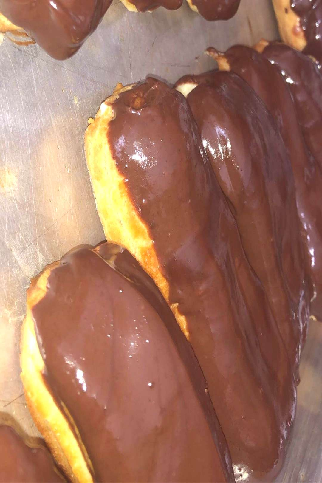 Freshly baked eclairs filled with yummy vanilla custard and long