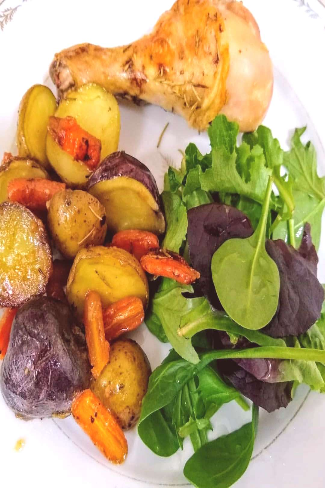 Todays dinner roasted drumsticks, mini potatoes and carrots and